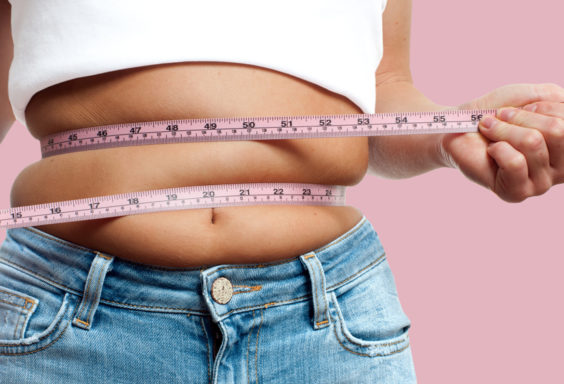 woman measuring wasteline - coolsculpting procedure